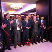 U.S. Ambassador P. Michael McKinley and Afghan officials cut ribbon to open the premier Exhibition Afghanistan, Dubai.