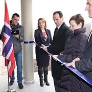 US Ambassador Jacobson and leaders from Kosovo's judiciary cut the inaugural ribbon