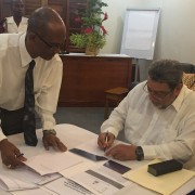 Prime Minister and Minister of Legal Affairs of St. Vincent and the Grenadines Dr. Ralph Gonsalves  signs documents to endorse the CariSECURE Project and implement the Citizen Security Toolkit.
