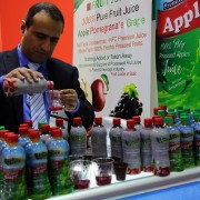 An Afghan trader pours juice samples for guests and buyers at the #Gulfood2017 in Dubai, February 27, 2017.
