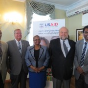 USAID Mission Director Christopher Cushing joins officials during the YES Project Launch in Guyana.