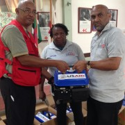 USAID/OFDA Disaster Relief Management Specialists  hand over the generators purchased by USAID
