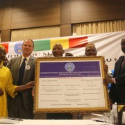 At the One Health Platform Launch, participants hold a  certificate