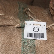 A traceability tag on a sack of coffee ready for export.