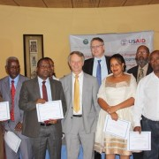 New grantees pose with USAID Ethiopia Mission Director Dennis Weller (center front) and CNFA Chief of Party Marc Steen.