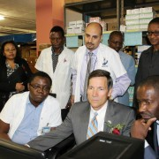 U.S. Ambassador Thomas Daughton and the Minister for Health and Social Services, Dr. Bernard Haufiku, test the new web-based com