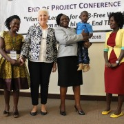 Ambassador Malac and Health Minister Opendi pose with survivors of MDR-TB.