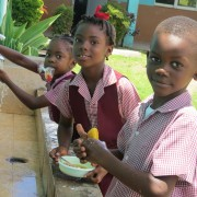 These students from St.Paul's primary School are saving water while using water-saving taps installed at the facility.