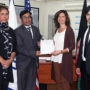Sepideh Keyvanshad, USAID/Afghanistan Depute MD (2nd from right) shows a signed agreement for the Development Credit Authority.