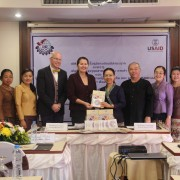 USAID Laos Country Director Alexandria Huerta presented handbooks on the use of natural dyes on handicraft production to the Ministry of Industry and Commerce