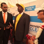 Belcash CEO Vince Mountaga Diop explains to U.S. Ambassador Haslach how HelloCash can be used to pay for water.