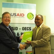 Mission Director Chris Cushing , officially hands over RRACC Demonstration project documents to Alvin DaBreo, Minister with resp