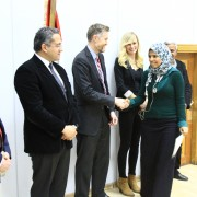 USAID/Egypt Economic Growth Director Brinton Bohling congratulates graduates who participated in a USAID-funded field school for Ministry of Antiquities employees. This field school provided hands-on learning opportunities to strengthen the site management skills of site inspectors.