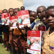 P2 Pupils of Sowodadzen Primary School in the Jomoro District of the Western Region displaying the materials the school received.