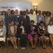 USAID Haiti Mission Director Jene Thomas with representatives from local civil society organizations and businesses.