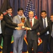 Students from American University of Afghanistan pose for a photo with the US Ambassador, Michael McKinley (center)