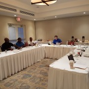 Tim Callahan, meets with members of the Barbados Surge team