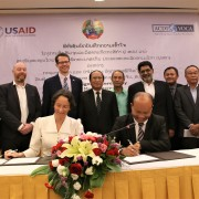 Mr. Sypaphai Xaisongkham (seated on right), Director General of Department of Technical Extension and Agro-processing, joined Ms. Sophie Walker (seated on left), Chief of Party ACDI/VOCA Laos, to sign the MOU while U.S. Chargé d'Affaires Colin Crosby (standing, fifth from left) and Dr. Bounkhouang Khambounheaung (standing, sixth from left), Vice Minister of Agriculture and Forestry, witnessed the October 4 event in Vientiane.