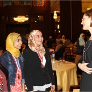 USAID Mission Director Sherry F. Carlin speaks with students and teachers