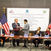 USAID Mission Director Herbie Smith and Minister of Agriculture, Irrigation and Livestock Assadullah Zamir signed an agreement.
