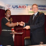 Gwendoline Abunaw and Matthew Smith shaking hands at the announcement of the partnership between USAID and Ecobank Cameroon.