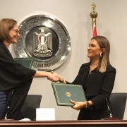 USAID/Egypt Mission Director Sherry F. Carlin and Minister of Investment and International Cooperation Dr. Sahar Nasr shake hands after signing bilateral assistance agreements worth $16.5 million.