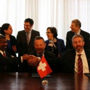 Representatives of Governments of Sweden, U.S.A. and Switzerland shakes hands following signing of STAR agreement