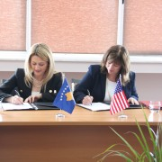 USAID Director Maureen A. Shauket and Minister of Trade and Industry Mimoza Kusari-Lila sign the MOU