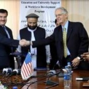Dr. Obaidullah Obaid, Minister of Higher Education of Islamic Republic of Afghanistan shakes hands with Reid Lohr, Manager of US