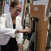 US Charge D'Affaires Kelly Degnan tests the bottle crusher on Earth Day