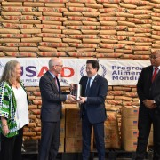 U.S. Ambassador James Swan (second left) handed a symbol of U.S. food assistance to WFP Country Representative Pablo Recalde.