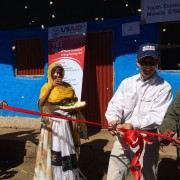 U.S. Deputy Chief of Mission to Ethiopia Peter Vrooman cuts a ribbon to officially open the first of up to 30 youth economic str