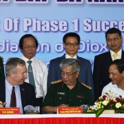 Vietnam's Deputy Prime Minister Vu Duc Dam (Second right in the second row) observes the signing ceremony.