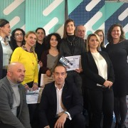 """United States Chargé d'Affaires Micaela Schweitzer-Bluhm with the winners of the citizen journalism competition and """"Top Tema na Vasha Strana"""" team"""