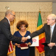 Gary C. Juste being sworn in as USAID Mission Director to Mali