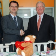 Minister of Health Dr. Ferid Agani and USAID Acting Mission Director Christopher Edwards admire the new, child friendly medical