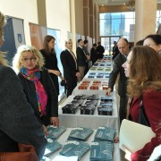 U.S. Charge d'Affaires (center, right)) Kelly Degnan admires exhibits at the local governance conference in Pristina.