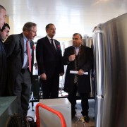 Ambassador Cekuta (center) tours the facility after the official opening.