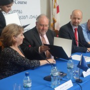 Mission Director Stephen M. Haykin signs MOU.