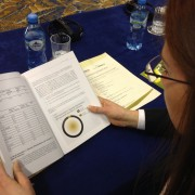 A woman reading a booklet with survey research findings