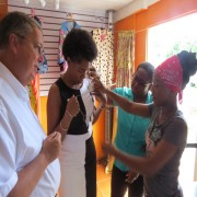 Tasnica Lovell of  'Angels Couture'  discusses  her business and merchandise  with USAID Mission Director, Chris Cushing