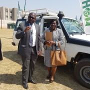 Minister Chilufya receives a set of car keys from Dr. Musumali after the handover of five 4x4 vehicles to assist the Ministry of Health's expansion of maternal and child services across Zambia.