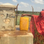 Women fill jerrycans at a water point in the Somali Region.