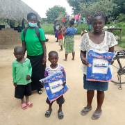 A family receives insecticide-treated bed nets in Lavushimanda District in Muchinga Province, Zambia