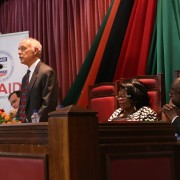 A photo of USAID/Zambia Mission Director Dr. Michael Yates addressing the Zambian Parliament advocating against GBV.
