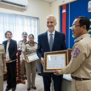Sean Callahan, USAID Deputy Mission Director, presents Certificates of Completion to Police Trainees
