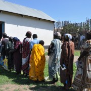 Program participants stand in line to receive a cash transfer for food outside a training facility in Juba, South Sudan