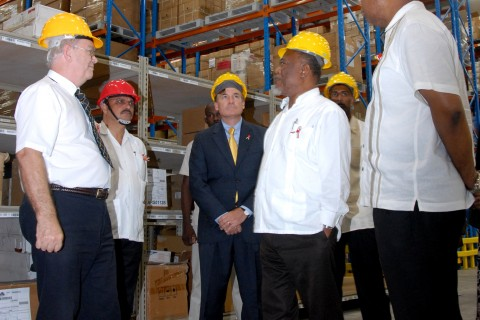 U.S. and Ghana officials tour new warehouse.