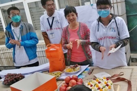 Former multi-drug resistant tuberculosis patient Huang Juan (right) celebrates the last day of her multi-drug resistant tubercul