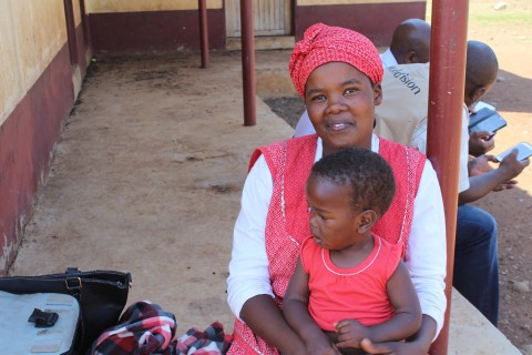 Setsabile and her baby Njabulo wait to receive food assistance through USAID partner World Vision.